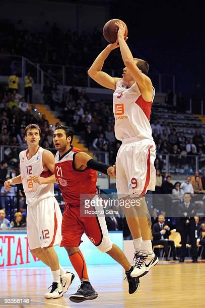 Michal Kremen of CEZ Nymburk and Pietro Aradori of Lauretana Biella in action during the Eurocup Basketball Regular Season 20092010 Game Day 1...