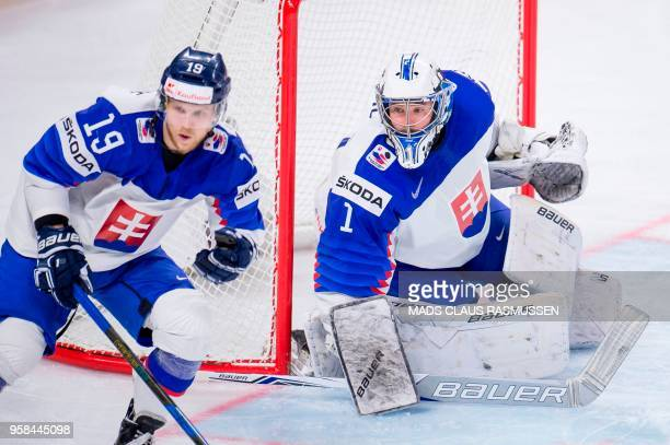 Michal Kristof of Slovakia and Marek Ciliak of Slovakia eye the puck during the group A match Russia vs Slovakia of the 2018 IIHF Ice Hockey World...