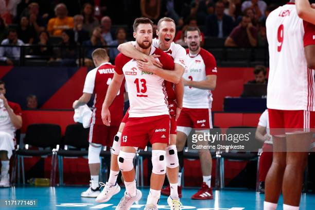 Michal Kubiak and Pawel Zatorski of Poland celebrates a point with during the EuroVolley 2019 Third place match between France and Poland at...