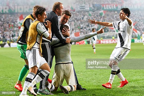 Michal Kucharczyk of Legia Warsaw celebrates with team mates and trainer coach Besnik Hasi of Legia Warsaw after scoring during Legia Warsaw v...