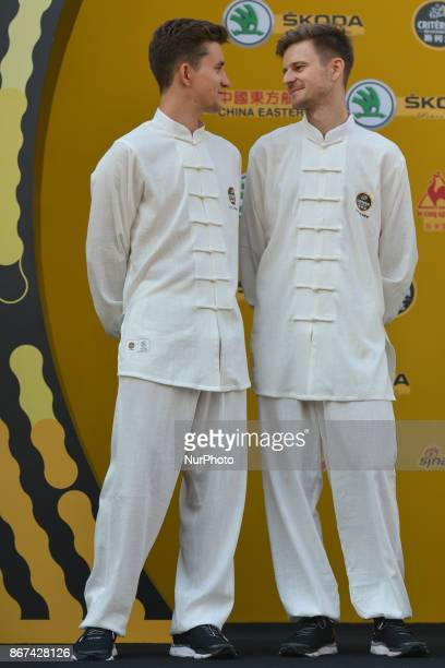 Michal KWIATKOWSKI and Michal GOLAS from Team SKY wear traditional Chinese dresses during the 1st TDF Shanghai Criterium 2017 Media Day On Saturday...