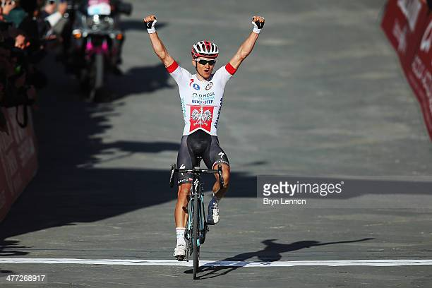 Michal Kwiatkowski of Poland and Omega PharmaQuickStep crosses the finish line to win the 2014 Strade Bianchi from to San Gimignano to Siena ll Campo...