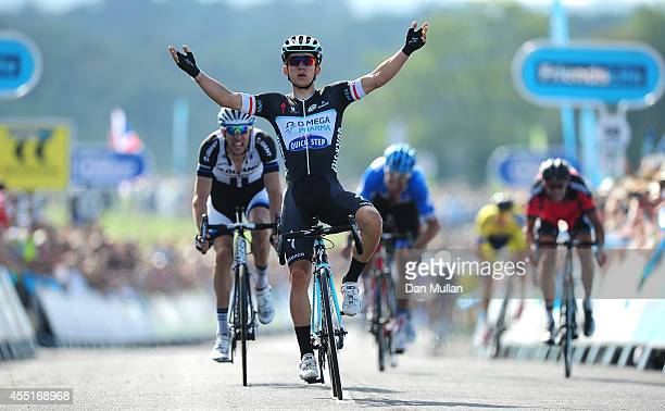Michal Kwiatkowski of Poland and Omega Pharma-QuikStep celebrates as he crosses the line to win during Stage Four of the 2014 Tour of Britain from...