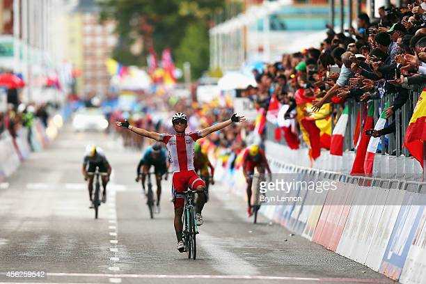 Michal Kwiatkowski of Poland celebrates winning the Elite Men's Road Race on day seven of the UCI Road World Championships on September 28 2014 in...