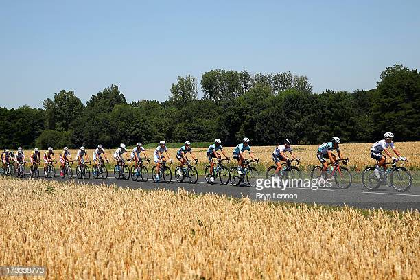 Michal Kwiatkowski of Poland, Sylvain Chavanel of France and Mark Cavendish of Great Britain and of Omega Pharma-Quickstep lead the peloton during...