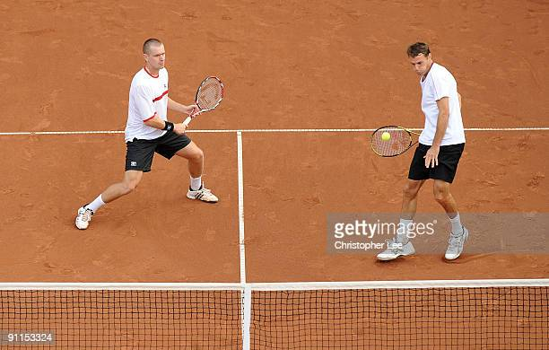 Michal Mertinak of Slovakia and Frantisek Cermak of Czech Republic in action against Pablo Cuevas of Uruguay and Marcel Granollers of Spain during...
