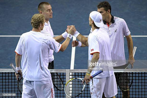 Michal Mertinak of Slovakia and Frantisek Cermak of the Czech Republic shake hands with Dmitry Tursunov of Russia and Andreas Seppi of Italy after...