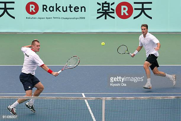Michal Mertinak of Slovakia returns a shot with his partner Frantisek Cermak of the Czech Republic in their doubles match against Andreas Beck and...