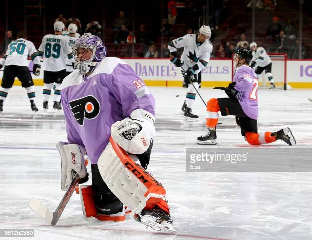 Michal Neuvirth and Danick Martel of the Philadelphia Flyers stretch during warmups before the game against the San Jose Sharks on November 28 2017...