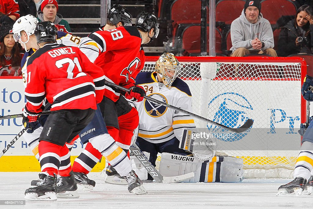 Michal Neuvirth #34 of the Buffalo Sabres in action against the New Jersey Devils at the Prudential Center on February 17, 2015 in Newark, New Jersey. The Devils defeated the Sabres 2-1 after a shootout.