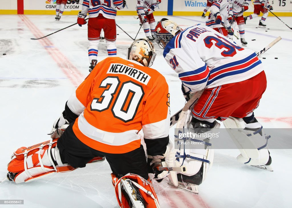 Michal Neuvirth #30 of the Philadelphia Flyers and Ondrej Pavelec #31 of the New York Rangers chat during warmups prior to their preseason game at the Wells Fargo Center on September 26, 2017 in Philadelphia, Pennsylvania.