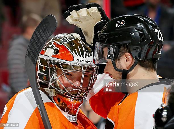 Michal Neuvirth of the Philadelphia Flyers is congratulated by teammate Scott Laughton after the win over the Montreal Canadiens at the Wells Fargo...