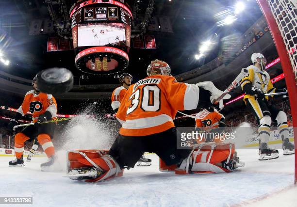 Michal Neuvirth of the Philadelphia Flyers is unable to stop a shot by Riley Sheahan of the Pittsburgh Penguins in the third period in Game Four of...