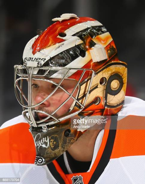Michal Neuvirth of the Philadelphia Flyers looks on against the New Jersey Devils during the game at Prudential Center on March 16 2017 in Newark New...