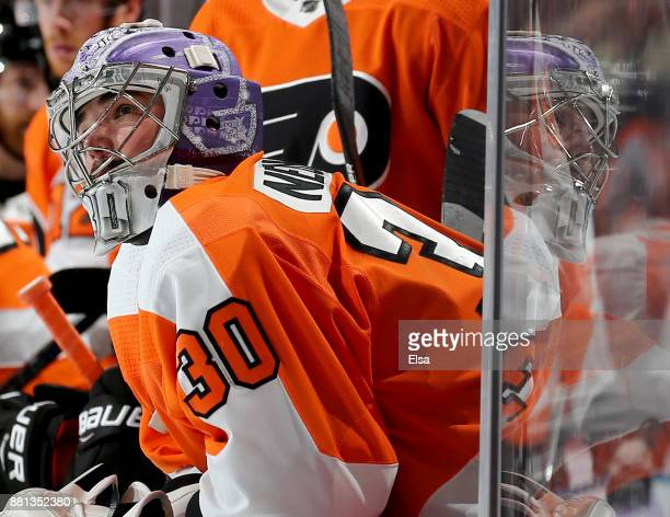 Michal Neuvirth of the Philadelphia Flyers looks on from the bench as the Philadelphia Flyers pulled him in the final minutes of the game in an...