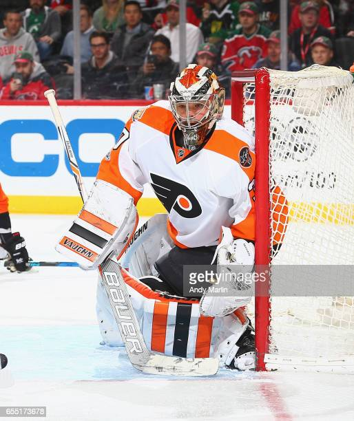 Michal Neuvirth of the Philadelphia Flyers makes a glove save against the New Jersey Devils during the game at Prudential Center on March 16 2017 in...