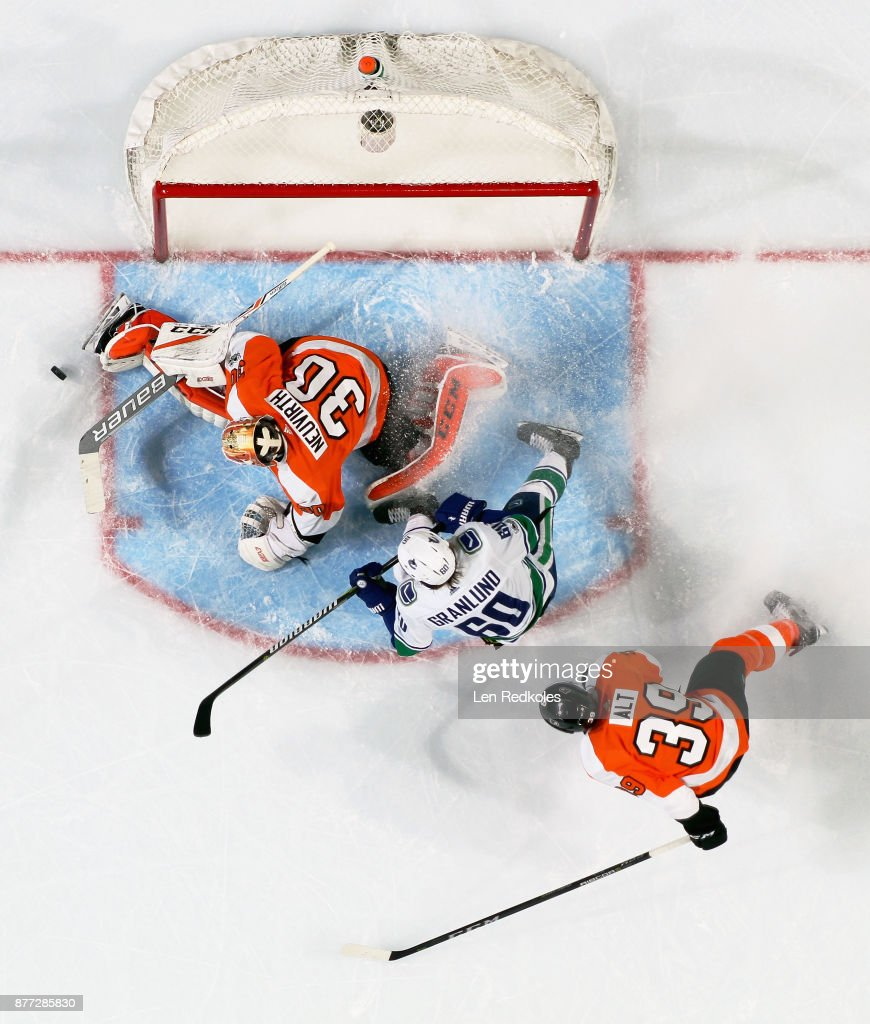 Michal Neuvirth #30 of the Philadelphia Flyers makes a save against Markus Granlund #60 of the Vancouver Canucks on November 21, 2017 at the Wells Fargo Center in Philadelphia, Pennsylvania.The Canucks went on to defeat the Flyers 5-2.