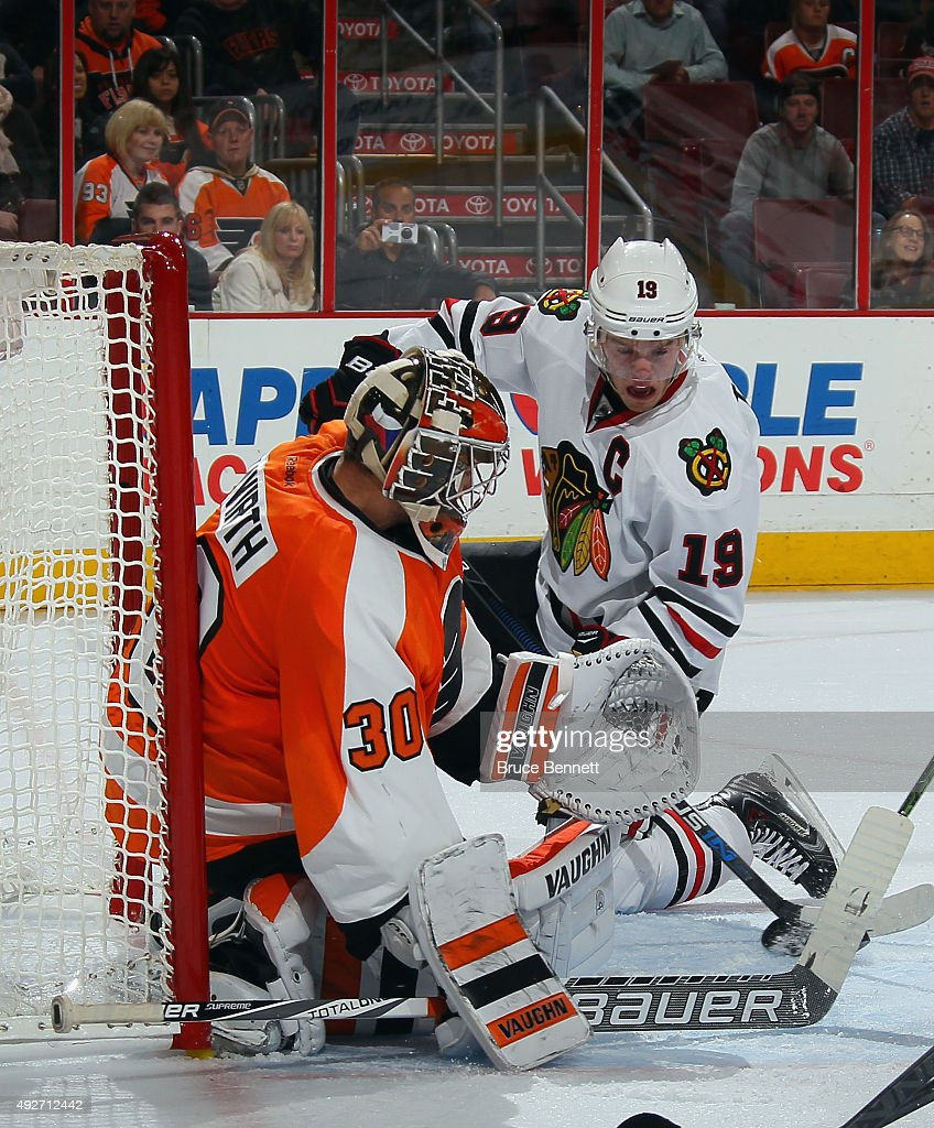 Michal Neuvirth #30 of the Philadelphia Flyers makes a third period save on Jonathan Toews #19 of the Chicago Blackhawks at the Wells Fargo Center on October 14, 2015 in Philadelphia, Pennsylvania. The Flyers defeated the Blackhawks 3-0.