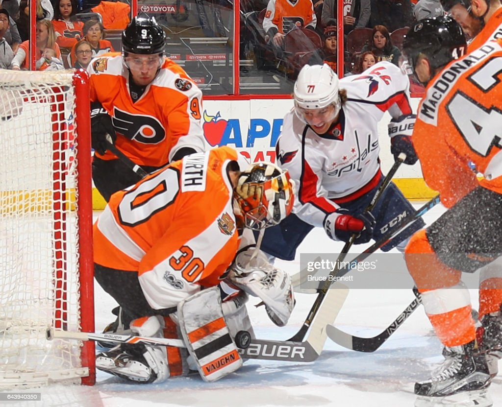 Michal Neuvirth #30 of the Philadelphia Flyers makes the stick save on T.J. Oshie #77 of the Washington Capitals during the first period at the Wells Fargo Center on February 22, 2017 in Philadelphia, Pennsylvania.