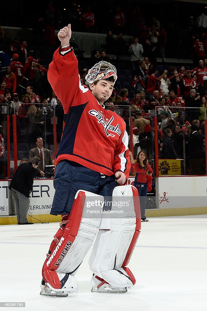 Michal Neuvirth #30 of the Washington Capitals celebrates after the Capitals defeated the Toronto Maple Leafs 3-2 during an NHL game at Verizon Center on January 10, 2014 in Washington, DC.