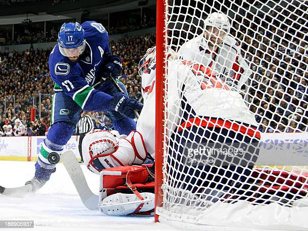 Michal Neuvirth of the Washington Capitals makes a save off the shot of Ryan Kesler of the Vancouver Canucks at Rogers Arena on October 28 2013 in...