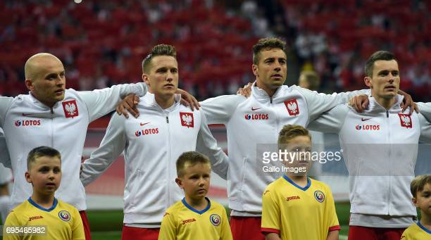 Michal Pazdan Karol Linetty Thiago Cionek and Krzysztof Maczynski of Poland line up during the 2018 FIFA World Cup Russia eliminations match between...