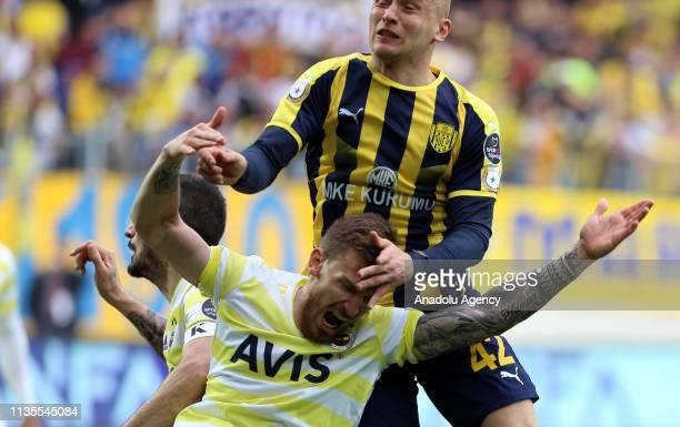 Michal Pazdan of MKE Ankaragucu and Serdar Aziz of Fenerbahce vie for the ball during Turkish Super Lig soccer match between MKE Ankaragucu and...