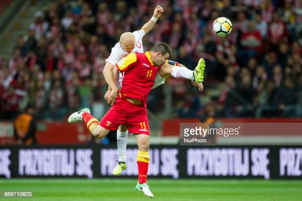 Michal Pazdan of Poland and Fatos Beciraj of Montenegro during the FIFA World Cup 2018 Qualifying Round Group E match between Poland and Montenegro...