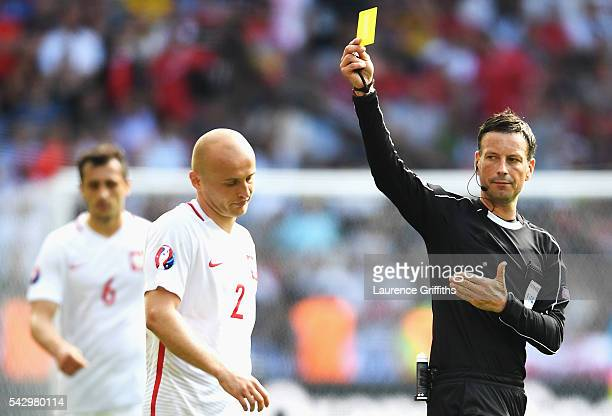 Michal Pazdan of Poland reacts after shown a yellow card by referee Mark Clattenburg during the UEFA EURO 2016 round of 16 match between Switzerland...