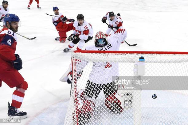 Michal Repik of the Czech Republic scores a goal against Jonas Hiller of Switzerland in the first period during the Men's Ice Hockey Preliminary...