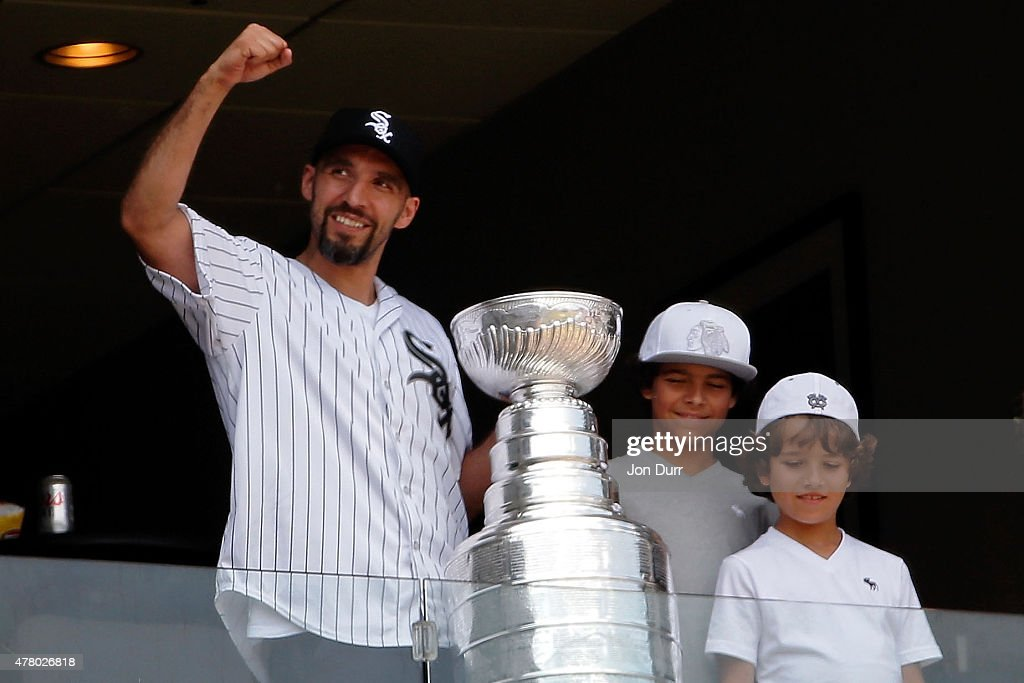 Michal Roszival #32 of the Chicago Blackhawks with the Stanley Cup in between innings during the game between the Chicago White Sox and the Texas Rangers at U.S. Cellular Field on June 21, 2015 in Chicago, Illinois. The Chicago White Sox won 3-2 in eleven innings