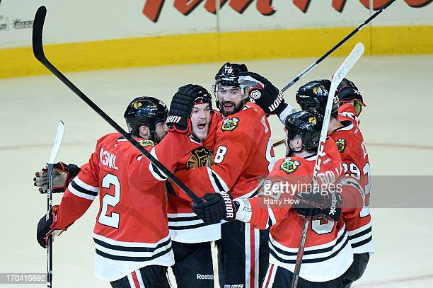 Michal Rozsival, Andrew Shaw, Nick Leddy, Dave Bolland and Bryan Bickell of the Chicago Blackhawks celebrate after Shaw scored the game-winning goal...