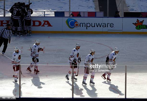 Michal Rozsival Ben Smith David Rundblad Daniel Carcillo and Marcus Kruger of the Chicago Blackhawks skate to the bench as members of the Washington...