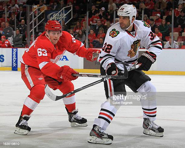Michal Rozsival of the Chicago Blackhawks passes the puck past Joakim Andersson of the Detroit Red Wings at Joe Louis Arena on March 3 2013 in...