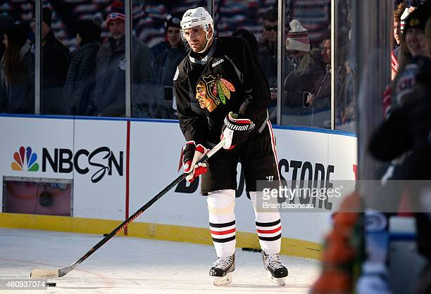 Michal Rozsival of the Chicago Blackhawks skates the puck into the sunlight during practice day prior to the 2015 Bridgestone NHL Winter Classic on...