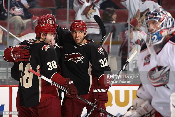 Michal Rozsival of the Phoenix Coyotes celebrates with teammates Vernon Fiddler and Mikkel Boedker after Rozsival scored a second period power play...
