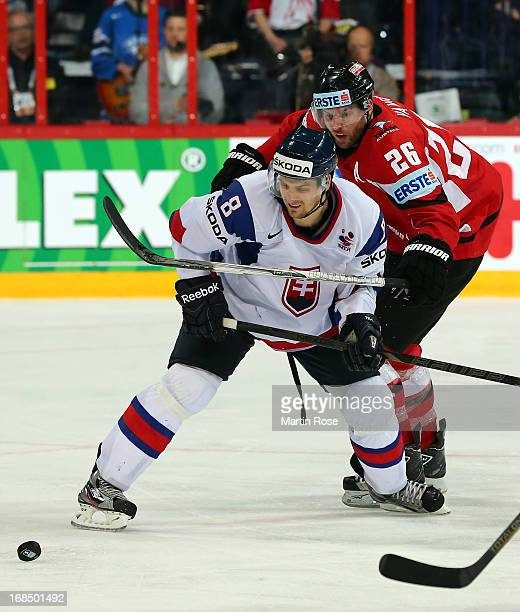 Michal Sersen of Slovakia and Thomas Vanek of Austria battle for the puck during the IIHF World Championship group H match between Slovakia and...