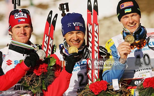 Michal Slesinger of the Czech Republik Ole Einar Bjoerndalen and Andriy Deryzemlya of the Ukraine present their medals after the Men's 10 km sprint...