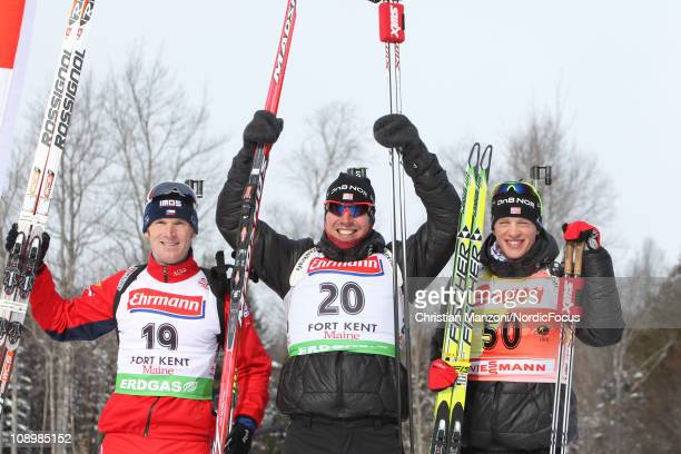Michal Slesingr of Czech Republic celebrates with Emil Hegle Svendsen of Norway and Tarjei Boe of Norway competes in the men's sprint during the E.ON...