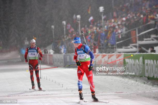 Michal Slesingr of Czech Republic looks back to Ole Einar Bjoerndalen after winning the sprint for second place in the men's relay during the e.on...