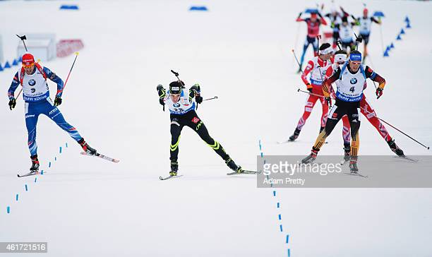 Michal Slesingr of the Czech Republic, Quentin Fillon Maillet of France and Simon Schempp of Germany sprint for the finish line during the IBU...