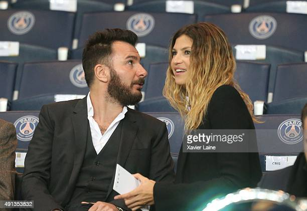 Michal Youn and his wife Isabelle Funaro attend the French Ligue 1 between Paris SaintGermain and Olympique de Marseille at Parc Des Princes on...