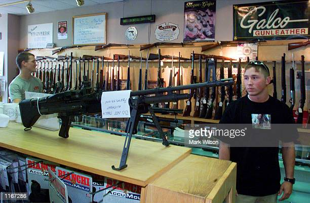 Michale Redendo looks at an assult weapon on sale at Blue Ridge Arsenal October 3 2001in Chantilly VA Guns sales have risen across America since the...