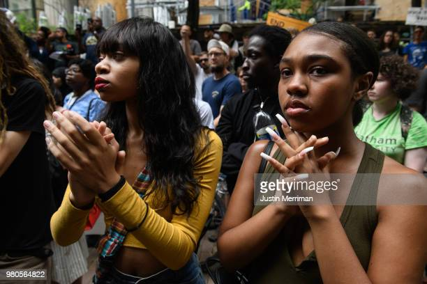 Michale Taylor of Turtle Creek cries as she stands at a rally with More than 200 people gathered for a rally to protest the fatal shooting of an...