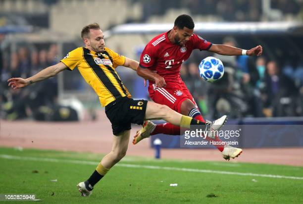 Michalis Bakakis of AEK Athens challenges for the ball with Serge Gnabry of Bayern Munich during the Group E match of the UEFA Champions League...