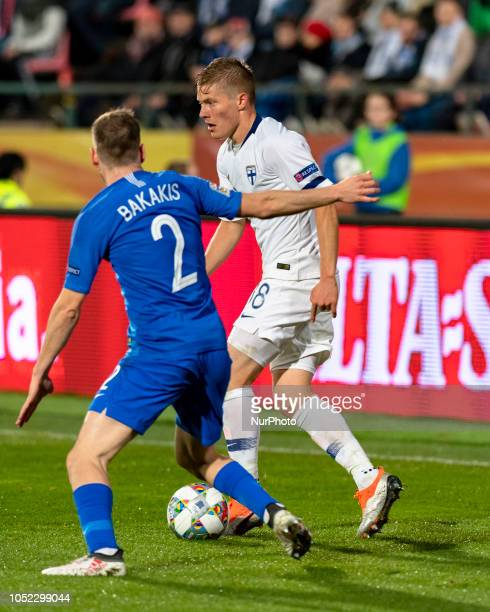 Michalis Bakakis of Greece vies Jere Uronen of Finland during the UEFA Nations League group stage football match Finland v Grece in Tampere Finland...