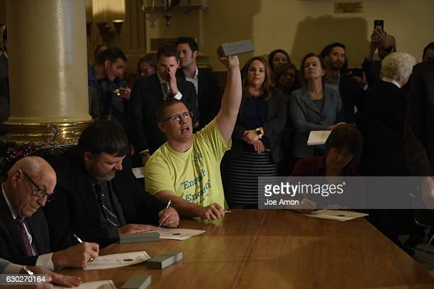 Micheal Baca casts his vote for vice president on his pen box after he was replaced by Celeste Landry of Boulder as a Colorado member of the...