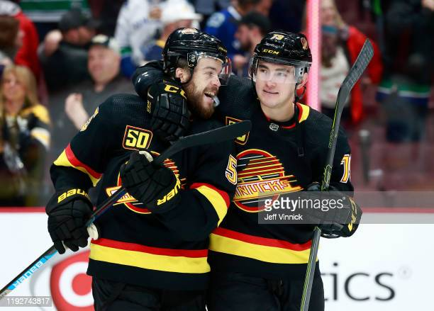 Micheal Ferland and Oscar Fantenberg of the Vancouver Canucks celebrate their win during their NHL game against the Buffalo Sabres at Rogers Arena...