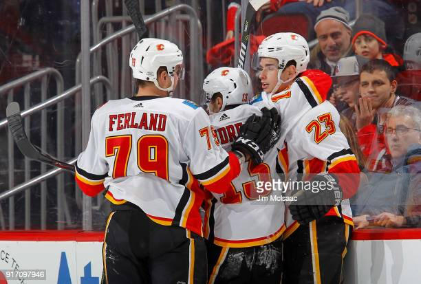 Micheal Ferland Johnny Gaudreau and Sean Monahan of the Calgary Flames celebrate a goal against the New Jersey Devils on February 8 2018 at...