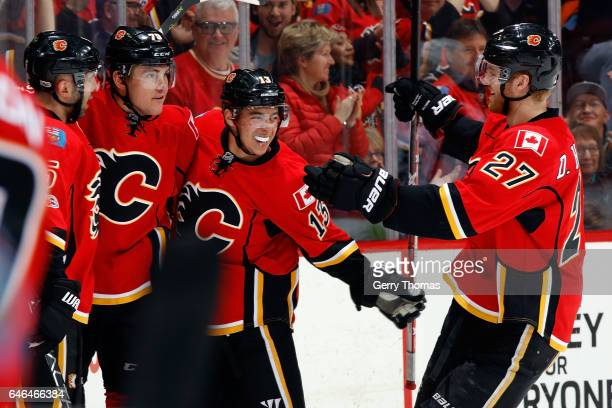 Micheal Ferland Johnny Gaudreau and teammates of the Calgary Flames skates celebrate a goal against the Los Angeles Kings during an NHL game on...
